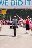 SOUTHAMPTON, UK - JULY 14: Press photographer and Town Crier at the start of the annual Race for Lif