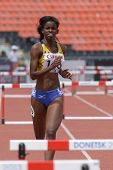 DONETSK, UKRAINE - JULY 11: Tia-Adana Belle of  Barbados compete in semi-final of 400 m hurdles duri