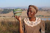 pic of zulu  - Traditional African Zulu Woman Selling Wire Baskets - JPG