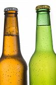 2 Cold Frosted Beer Bottles On White Background