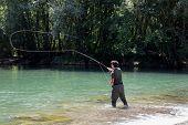Fisherman Casting In Fly Fishing