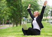 Successful  Businesswoman With Laptop And Arms Outstretched