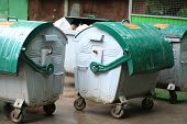 pic of dustbin  - image of many green dustbin at rain