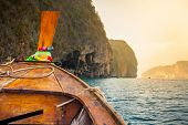 image of bay leaf  - Traditional wooden boat in a tropical bay on Koh Phi Phi Island - JPG