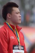 DONETSK, UKRAINE - JULY 14: Bronze medalist in discus throw Yulong Cheng of China on medal ceremony