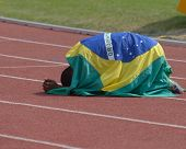 DONETSK, UKRAINE - JULY 14: Silver medalist in 200 metres Vitor Hugo dos Santos of Brazil under national flag during 8th IAAF World Youth Championships in Donetsk, Ukraine on July 14, 2013