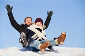 Young Happy Couple Sledging