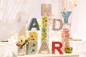 Sweet Table As Candy Bar With Different Sweets On Dinner Or Event Party.