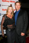 John Schneider and guest at the Los Angeles premiere of