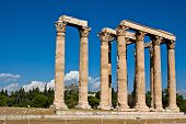 stock photo of olympian  - The strong columns of Temple of Olympian Zeus with the Mount Lycabettus on the background Athens Greece - JPG