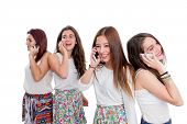 Group Of Teen Girls Talking On Smart Phones