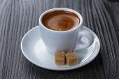 stock photo of sugar cube  - classic double espresso on wood table with sugar cubes - JPG