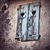 Wooden Window Shutters With Heart Shape