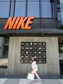 SANTA MONICA, CALIFORNIA - TUES. JUNE 24, 2014: Shoppers walk past a Nike sports clothing store in Santa Monica, California, on Tuesday, June 24, 2014.