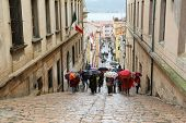 PORTOFERRAIO, ELBA, ITALY - MAY 03, 2014: Tourists walking up stairs in street on May 03, 2014 in Po