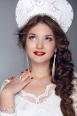 Fashion Girl Model In Exclusive Design Clothes On Manners Old-slavic. Close-up Portrait.