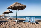 Sun chairs and umbrellas on beach
