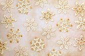 Old wooden christmas snowflake abstract design over mottled background.