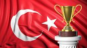 Golden trophy with Turkish flag in background