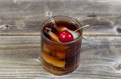 Rum And Cola With Large Red Cherry