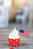 American patriotic holiday cupcake on wooden table