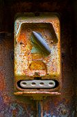 Old Electric Switch On Rusty Iron Wall