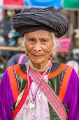 PAI, THAILAND - DECEMBER 11, 2014: Unidentified  Lisu tribe woman in traditional costume in Pai vill