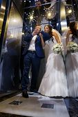 Wedding shot of  bride and groom in lift