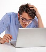 Worry businessman working on computer laptop