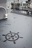NEW YORK - MAY 22: A ships helm painted on one of the decks on the amphibious dock landing ship USS