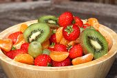 stock photo of satsuma  - Wooden bowl of strawberries - JPG