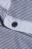 Black button on a shirt