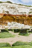 Red And Whilte Sandstone And Chalk Cliffs At Hunstanton, Norfolk,uk