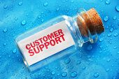 Customer support message in a bottle concept for support, assistance and help