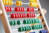 Abacus close up against gray background concept for counting, mathematics, education and finance
