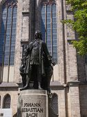 picture of leipzig  - The Neues Bach Denkmal meaning new Bach monument stands since 1908 in front of the St Thomas Kirche church where Johann Sebastian Bach is buried in Leipzig Germany - JPG