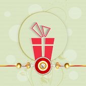 Beautiful greeting card design with rakhi and red gift box on green background for Happy Raksha Band