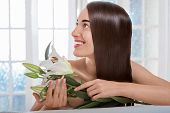 Portrait of woman with beautiful hair in spa salon