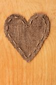 Heart  Of  Burlap, Lies On A Background Of Wood