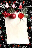 Blank sheet with Christmas decor on black background with lights
