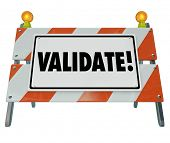 Validate word on a road construction barrier or barricade to illustrate certifying or verifying a result or outcome