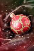 Beautiful Christmas ball on brown satin cloth
