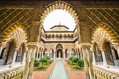 SEVILLE, SPAIN - CIRA 2014: The Royal Alcazar of Seville at the Courtyard of the Maidens. It is the oldest royal palace still in use in Europe.