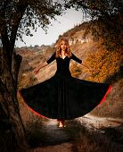 Young Woman Levitating In The Forest