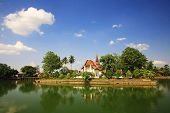 Temple With Reflection On Lake In Sukhothai
