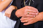 foto of bereavement  - Photo of elderly woman hands supported by young carer hands - JPG