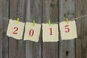 Year 2015 in red on antique parchment paper hanging on clothesline
