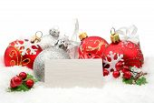 Red,silver Christmas Decoration On Snow With White Wishes Card