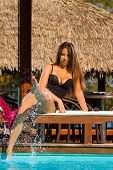 Beautiful woman relaxing on lounger in hotel, bali