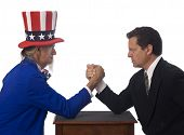 pic of lobbyist  - Uncle Sam arm wrestling with a businessman on a white background - JPG
